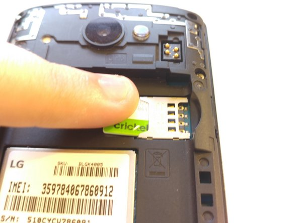 Press down on the SIM eject tab with a fingernail (or iFixit opening tool), and slide the SIM card out.