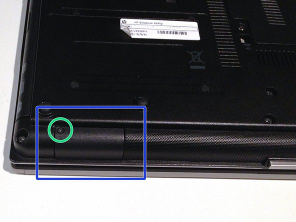 Locate the Bluetooth module cover on the bottom of the laptop