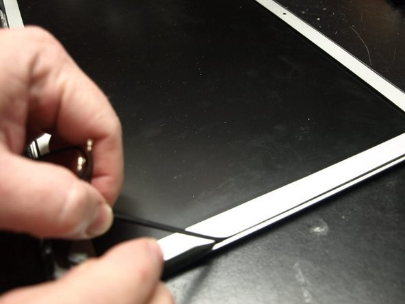 """Moving up the right side of the screen, begin pulling the bumper out slowly, in approximately 1""""-2"""" increments.  Continue around the screen until the bumper is complete removed."""