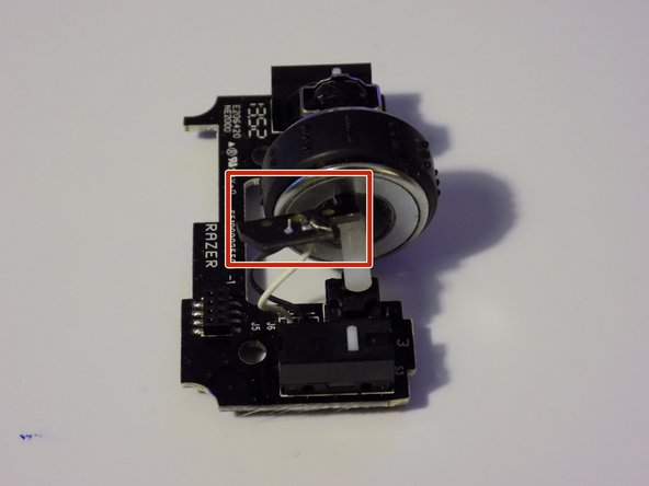Carefully remove the circuit board that is inside the scroll wheel.