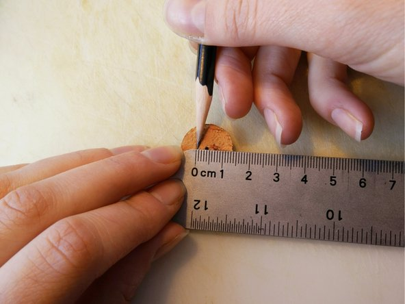 Using a ruler, measure half the diameter from Step 5 above and below the center mark.