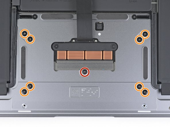 Use a T5 Torx driver to remove the following screws securing the trackpad: