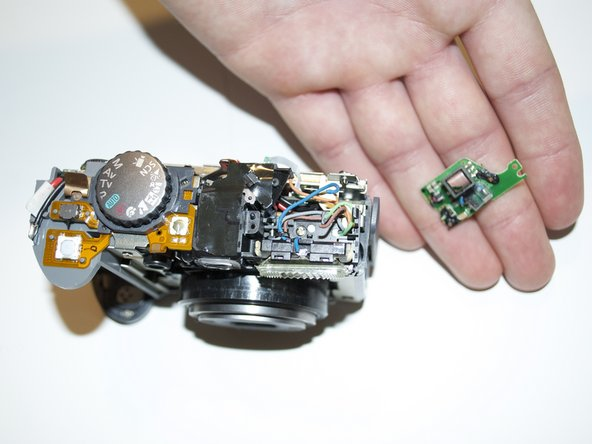 The flash logic board can now be removed from the camera and replaced.