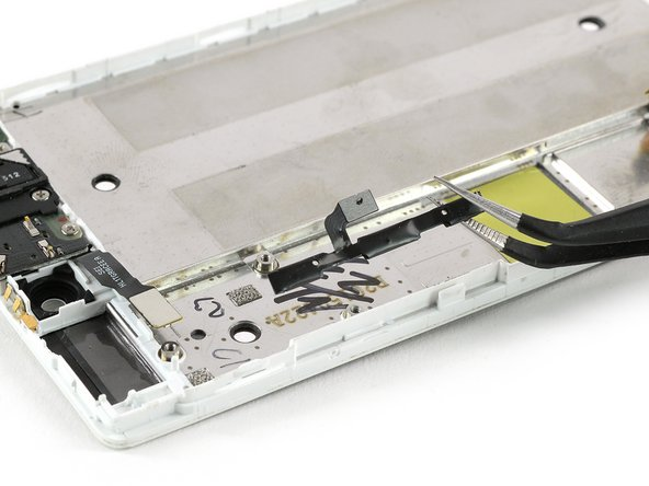 Remove the power and volume button flex cable.