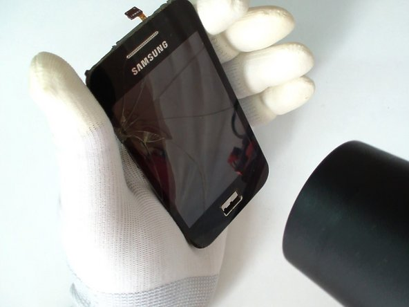 Use a hair dryer and warm the touch screen glass to make adhesive soften.