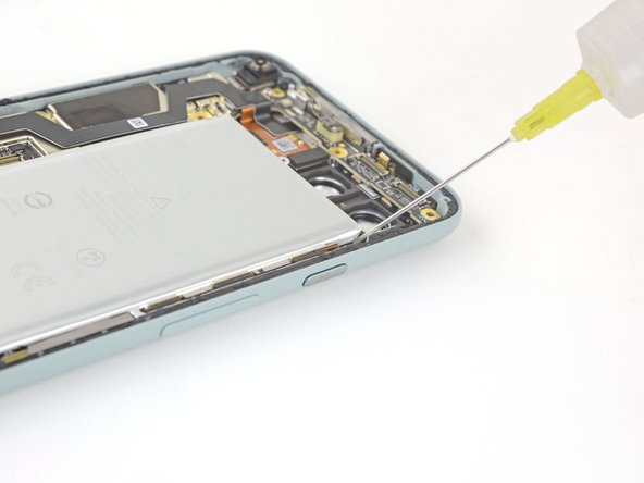 If any of the adhesive strips broke off underneath the battery and could not be retrieved, apply a few drops of high concentration (over 90%) isopropyl alcohol into the opening of the affected tab.