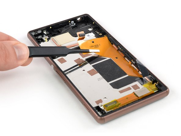 Carefully peel the magnetic charging cable off the midframe and remove it.