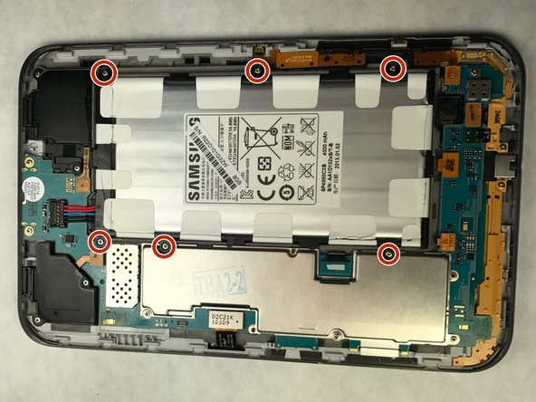 Using a Phillips head screwdriver, remove the 6 4mm screws holding holding the battery on the device.