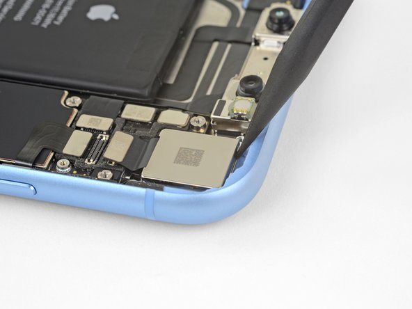 Insert the tip of a spudger at the top left corner of the camera, between the camera assembly and the iPhone's frame.