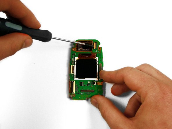 Using the head of a flathead screwdriver, flip the white segment of the socket that the camera's ribbon-wire runs into so that it is orientated vertically.