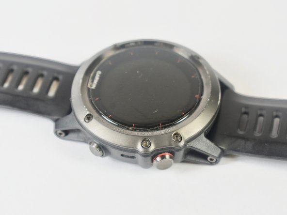 Use a T6 screwdriver to remove the five 1.7 mm screws from the watch face.