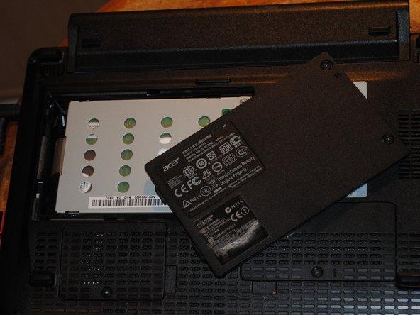Next, loosen both screws and remove plastic door.