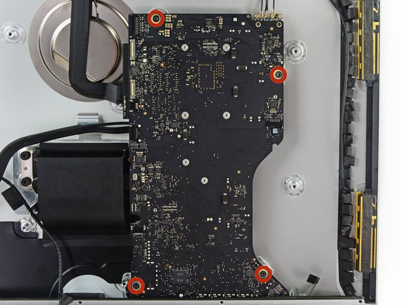 Remove the four 7.2 mm T10 screws securing the logic board to the rear enclosure.