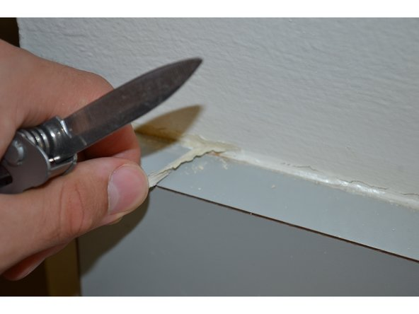 Peel off until all of the caulk is removed.