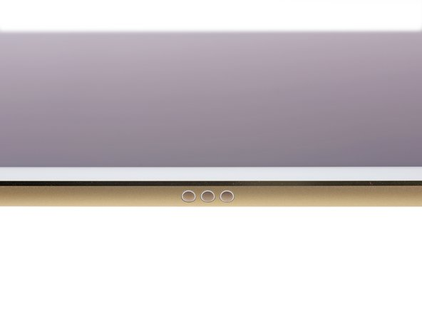 Peeking along the edge of the iPad, we spot a new accessory port—Apple's Smart Connector—making its debut appearance.