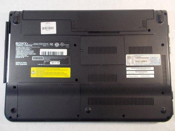 Flip the laptop so the bottom is facing up with the model number visible.