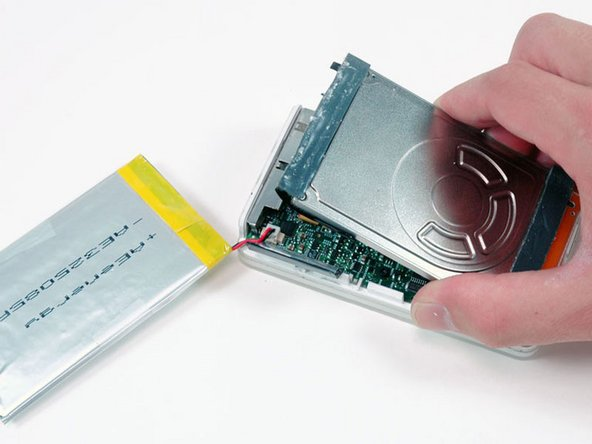Lift up the end of the hard drive near the Firewire port to allow easy access to the battery connector.