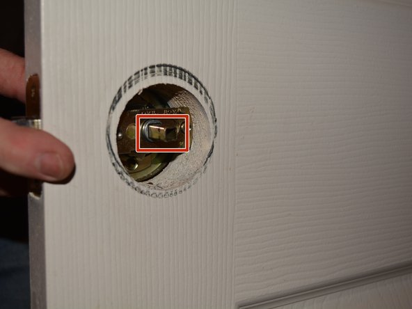 You will see the latch face plate (the rectangular piece of metal) where the latch of the door knob is located.