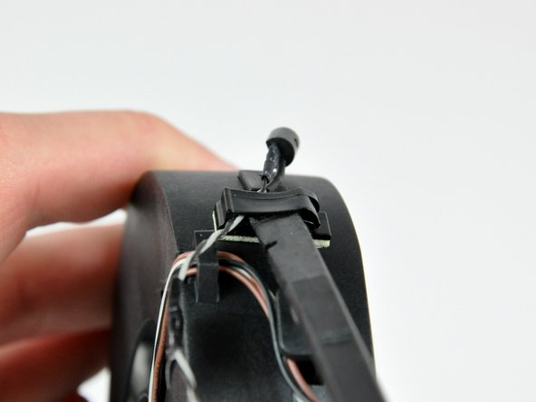 Use the flat end of a spudger to open the cable clip attached to the CPU fan.