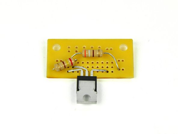 Insert the leads of the 240 Ω resistor through the holes indicated in step 7. This resistor will have a red, yellow, brown, and gold band on it. The direction of the resistor does not matter.