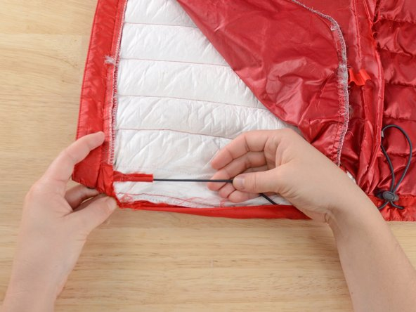 Unless the repair is at the very bottom edge of the garment, leave the drawcord intact. If you can work around it, it will be easier than removing it and sewing it back into place.