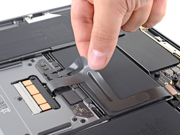 Carefully peel the trackpad cable off of the battery.