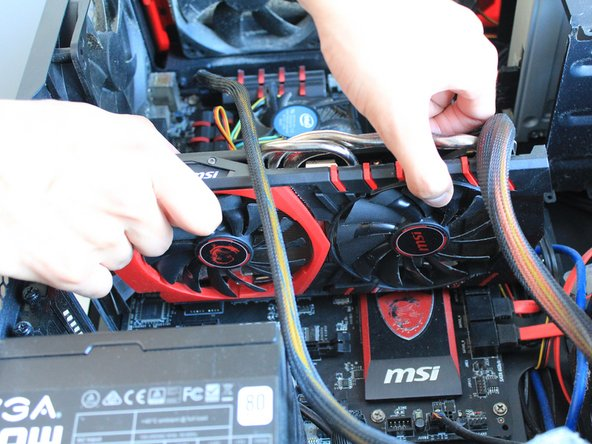 Gently pull the old GPU out.