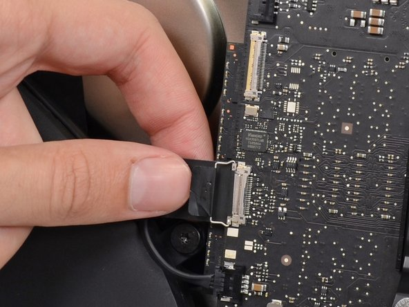 Pull the iSight camera cable straight away from its connector on the logic board.