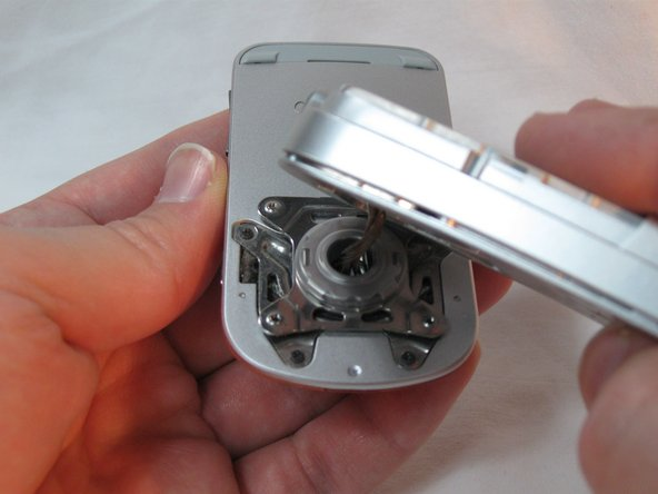The back housing is now disassembled, and the swivel assembly is revealed.