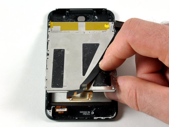 Separate the display from the front panel by gently lifting it.