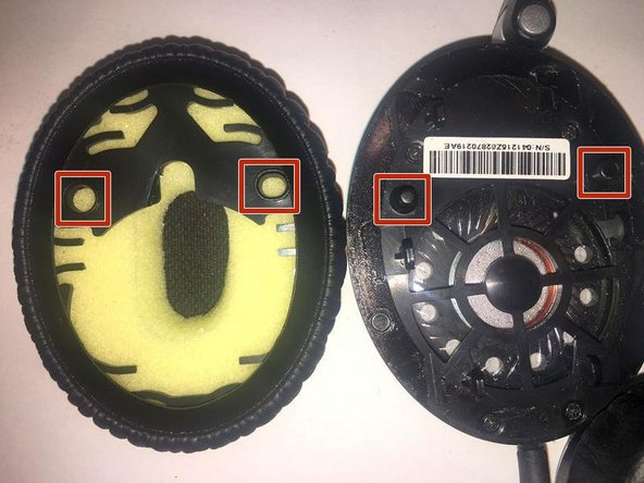 Position the cushion so that the orientation aligns the two holes with the two pins on the headphones