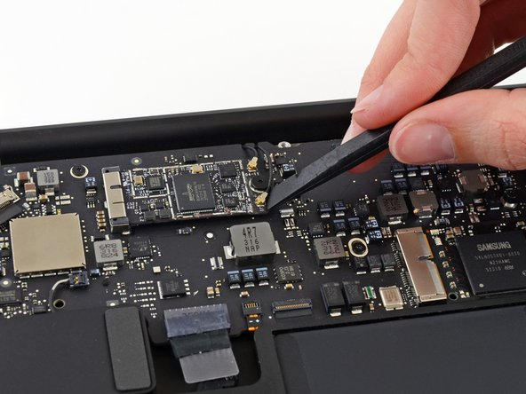 Use the flat end of a spudger to pry each of the antenna connectors up from their sockets on the AirPort/Bluetooth card.