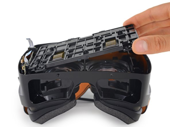 After removing four friendly Phillips screws, the display assembly lifts out of the headset with ease.