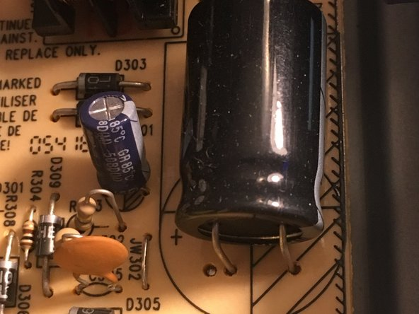 Capacitors can store large amounts of electricity. It is advised that you take the time to discharge them using the proper tool and not just a screwdriver. Touch both leads with a resistor to do this safely.
