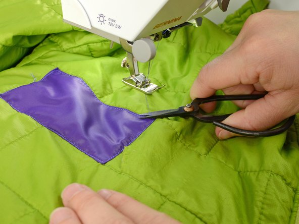Lift the needle and presser foot, freeing the garment from the sewing machine.