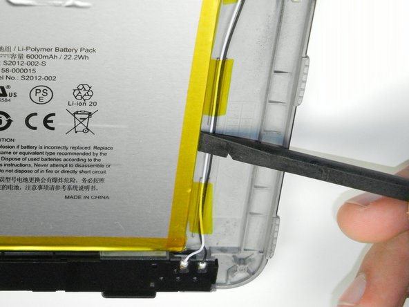 Starting at the outside edge of the battery, use the flat edge of a spudger to separate the battery from the rear of the device.