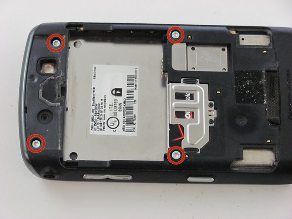 Remove the four silver Torx T6 3 mm screws on the back of the device.