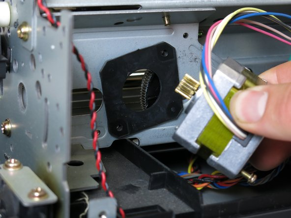 Remove the stepper motor by pulling it straight out.