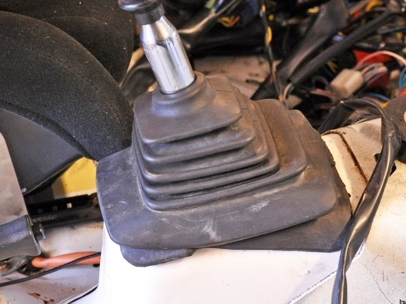 Lift the bottom of the shift boot to expose the shifting socket.