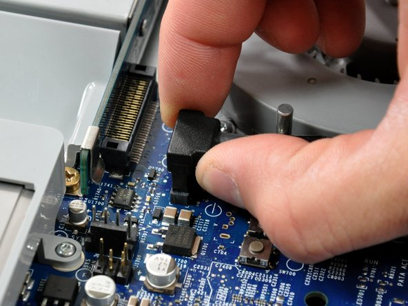 Disconnect the SATA data cable by pulling its connector straight up off the logic board.