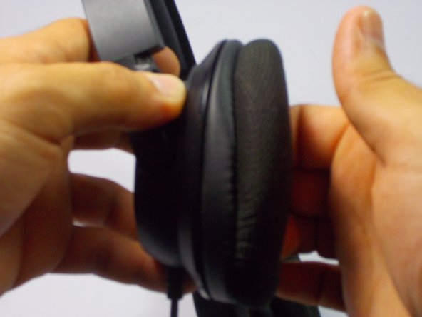 Remove the ear padding by separating the fabric piece from the plastic headphone piece.