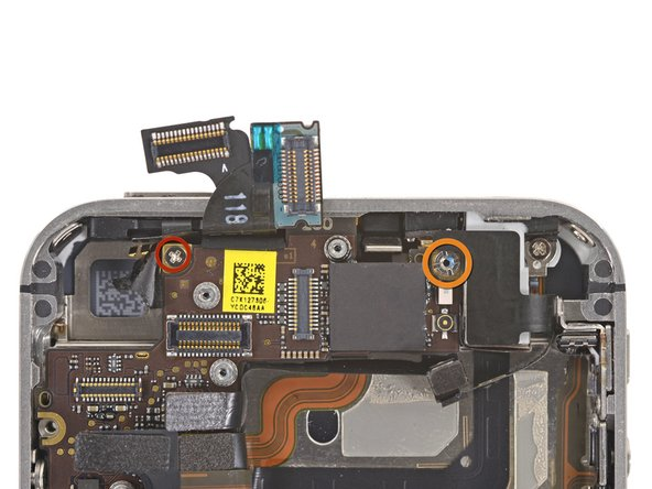 Remove the 2.5 mm Phillips #000 screw securing the logic board near the power button.