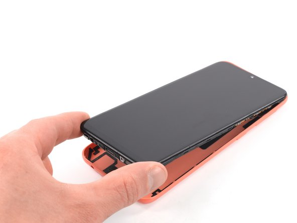Separate the phone assembly from the back cover.