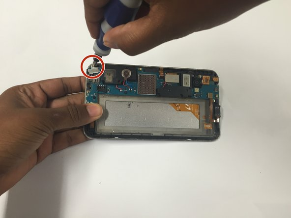 Remove the headphone jack by unscrewing the 10mm Phillips screw to its left then proceed to pry up the tab that attaches the headphone jack to the motherboard.