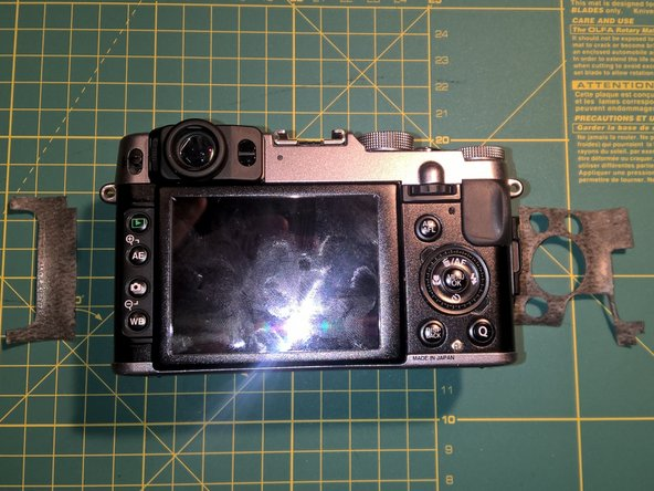 Remove four pieces of leatherette from the front and the back of the camera. Lift the edge of the leatherette and pull. The material itself is quite sturdy and the glue will still be good if you re-apply the pieces after you are finished.