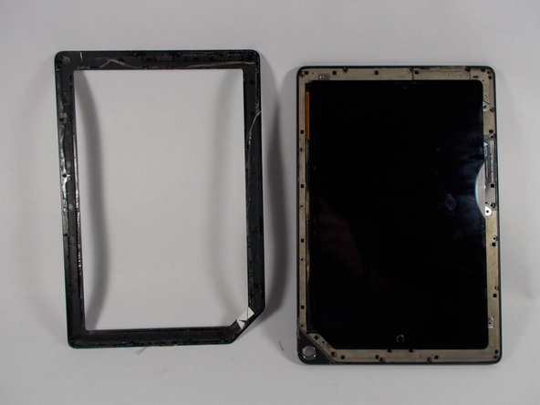 Wedge the plastic opening piece underneath the bottom left hand corner of the front frame. Pry the frame off of the Nook.