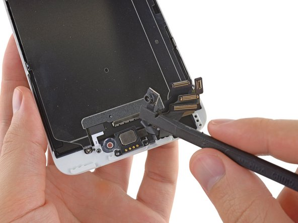 Use a the flat end of a spudger to pry up the front-facing camera and display cables, and gently push them aside.