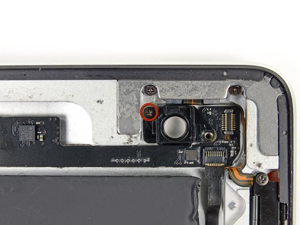 Remove the single 2.1 mm Phillips screw from the rear-facing camera housing.
