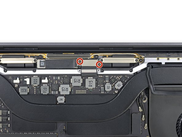 Using a T3 Torx driver, remove the two 1.7 mm screws securing the bracket for the display board cable connector.