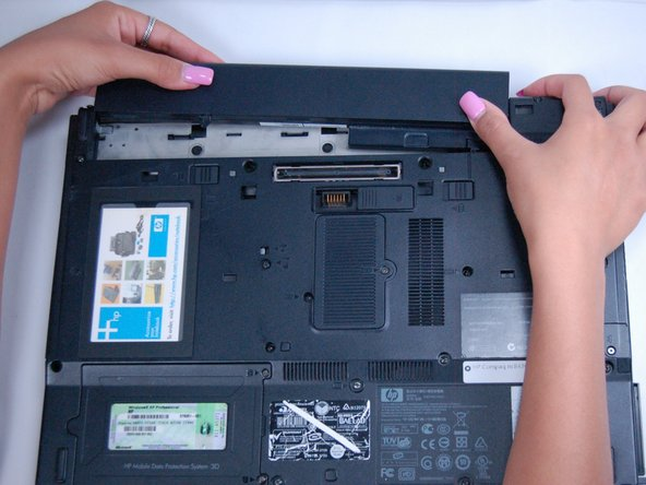 Slide the battery up and away from the laptop.